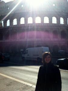 Caitlyn in front of the Colosseum